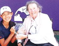 Golf legend Bell makes history