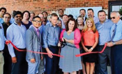 Ribbon cutting at new consulting firm's office
