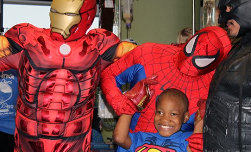 Superheroes swing by Brenner Children's Hospital