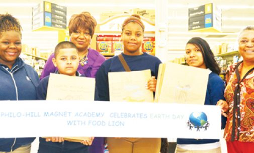 Students spread Earth Day messages with paper bag art