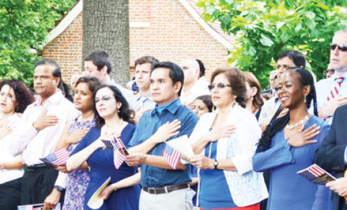New citizens take oath on patriotic holiday