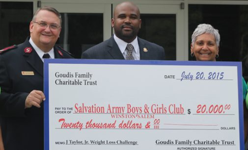 Councilman James Taylor presents check to Boys and Girls Club