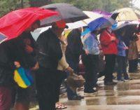 Hundreds gather around jail to pray