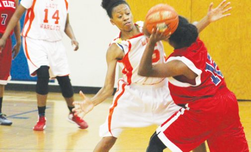 Suffocating defense sets tone in Lady Warcats' blow-out victory