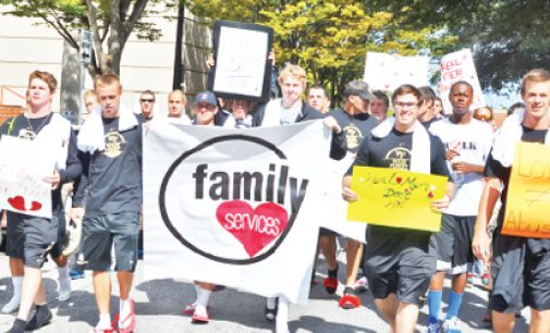 Men Take Symbolic Walk Against Abuse