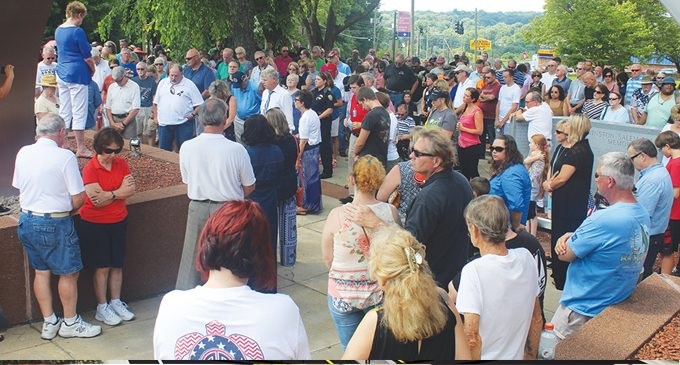 More than 100 people  gather to pray for law enforcement
