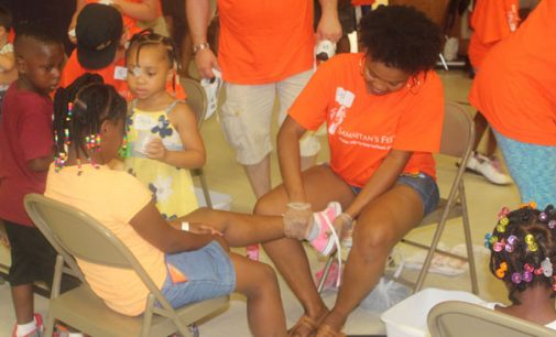 Thousands of children receive new shoes
