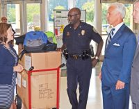 Police, lawyers deliver backpacks to schools