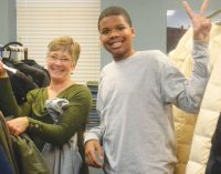 Local youth's art talents keep children warm with coat giveaway