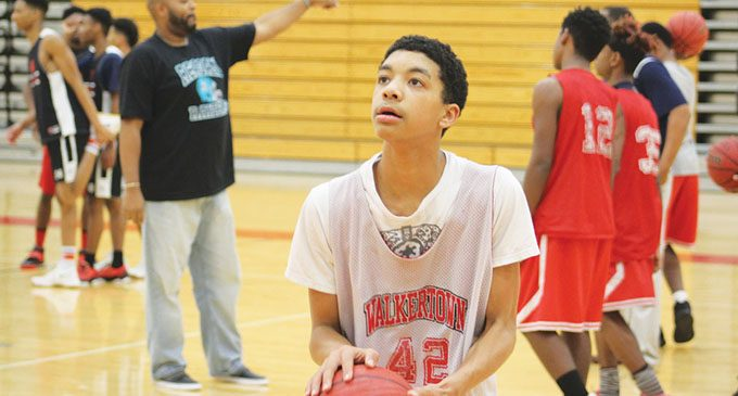 Walkertown JV guard Cameron Wilkerson talks to The Chronicle