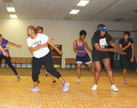 Fitness class grooves to gospel music while working out