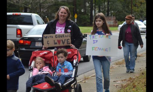 More than 100 citizens march to cast ballots