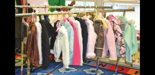 Local police officer donates more than 100 coats to children in need