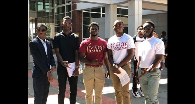Members of Kappa Alpha Psi register students to vote at WSSU