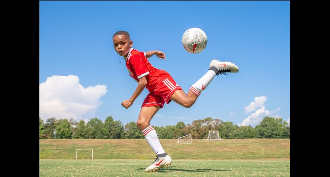 Young athlete focuses in on the game of soccer